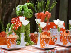 How about a carrot-themed table for your Easter celebration? So cute! (http://blog.hgtv.com/design/2011/04/12/easter-brunch-table-settings-centerpieces-decorations/?soc=Pinterest)