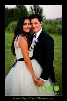 Beautiful formal portrait of the bride and groom, post nuptials in this green field and natural outdoor setting. Photo by Austin Wedding Photographers, Hyde Park Photography. Venue is the UT (University of Texas) Golf Club. http://www.HydeParkPhoto.com