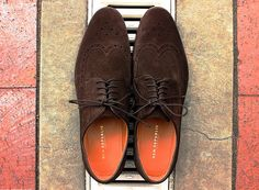 In Review: The New Republic by Mark McNairy Brown Suede Penton Wingtip  New Republic by Mark McNair Penton Brogue  $78.00  Oooh that smell cant you smell that smell  -Lynyrd Skynyrd  Oh you bet youll be able to smell em. Its that familiar cheap shoe pungent gasoline-like stank. But frankly after that dissipates (let em air out for a few days) youll be left with what most would consider a mighty fine shoe for around eighty bucks.  Deep chocolate brown. Sleeker thanmost longwings.  Slimmer and…