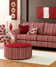 Dark Brown walls teamed with red furnishings