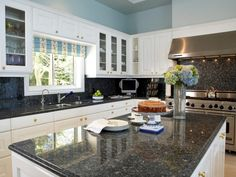 White Kitchen Cabinets With Gray Granite Countertops beautiful kitchen with dallas white granite counter tops #ogeeedge