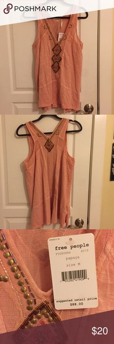 "NWT Free People Pink Beaded Flowy Tank Size Medium Brand new with tags! flowy pink tank embellished with beads in a diamond design in the front and back. v-neckline. semi sheer mesh panel in the back. side slits. 100% cotton. size medium. no signs of wear. length: 28"".  cross chest: 18.5"". Free People Tops Tank Tops"