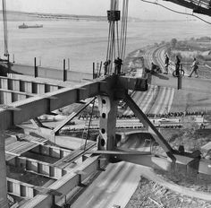 The construction of the massive bridge was dangerous work -- three workers were tragically killed and many more were injured. Here, workers try to connect a 390 ton chunk of steel to another as they work toward the completion on the structure.