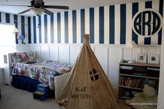 Playroom / Boy Bedroom. Navy and white striped wall and teepee. Very cool look.