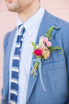 Bright Blue Suit & Colorful Boutonniere: http://www.stylemepretty.com/2015/07/10/personalized-style-details-for-the-groom/