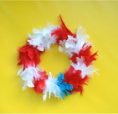 Fourth of July Feather Wreath - Make one this weekend! This Fourth of July craft is quick and easy to make.