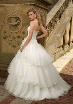 Princess wedding dresses. Little corset tie on back. Perfectly huge like a ball gown.