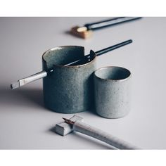 brush holder and waterpot : crackle glaze with varying percentages of iron oxide to alter the colour, extruded pen rest.