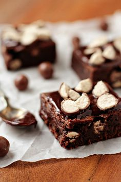 Whoppers Brownies YIELD: 12 browniesPREP TIME: 10 minutesCOOK TIME: 30-35 minutes INGREDIENTS: 4 ounces unsweetened chocolate; coarsely chopped 3/4 cup unsalted butter, cut into cubes 1 1/4 cups sugar 3 eggs 1 teaspoon pure vanilla extract 1/4 teaspoon salt 1 cup all-purpose flour 1 1/2 cup Whoppers, chopped  For the Ganache 4 ounces semisweet chocolate, chopped 1/2 cup heavy cream  DIRECTIONS: 1. Preheat oven to 350 degrees. Line an 8×8 inch baking pan with foil and spray with nonstick cooking spray.  2. Microwave chocolate and butter in a large bowl microwave-safe bowl at medium (50% power) for 3-4 minutes or until butter is melted.  3. Stir until chocolate is melted. Whisk in sugar, eggs, vanilla and salt. Gradually add in flour and stir until just combined.  4. Spread 1/2 the batter into prepared pan. Add an even layer of chopped Whoppers and cover with remaining 1/2 of brownie batter. Bake for 30-35 minutes; do not over bake.  5. Remove to cooling rack to cool completely. Before serving, prepare the ganache.  6. To make the ganache, pour the chopped chocolate into a medium mixing bowl, set aside. Pour the heavy cream into a microwave safe measuring cup (Pyrex) and microwave on high for about 1 minute or until bubbles begin to form on the surface. Take care to not overheat because the cream will boil over. Pour the hot cream over the chocolate and allow it to sit for about 3 minutes. Use a small whisk to combine the mixture into a smooth chocolate glaze. Spoon the ganache over the brownies. If desired, top with additional chopped Whoppers.  NOTES: - I purchased the Whoppers at Target in movie theater sized boxes. - Make sure you chop the Whoppers, they do harden a bit during the cooking process, so you don't want the pieces to be too big. However, if you pulverize them they'll completely disappear. - Wait until just before serving to top your brownies with the ganache and additional chopped Whoppers. - The brownies are very fudgy, make sure you allow them to cool completely before cutting into them. -  My Baking Addiction