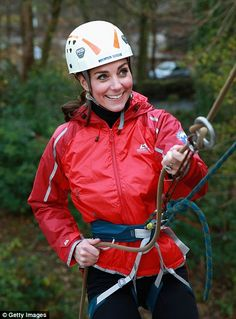 The sporty Duchess donned a red jacket, tight leggings, brown boots and a helmet as she st...