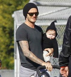 The time they both wore black hats and Harper's cheeks looked like this: | These Photos Of David And Harper Beckham Will Melt Your Heart