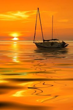 Boat on the water under a beautiful sunset