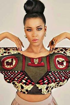 This stunning top with batwing sleeves has an extravagant African print and our gorgeous sista has got this look so right; by keeping the rest of her outfit and African Inspired Fashion, African Print Fashion, Africa Fashion, Fashion Prints, African Prints, African Patterns, African Wear, African Attire, African Women