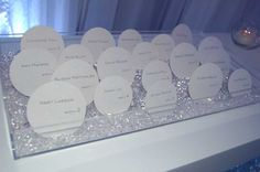 Escort cards would be displayed in boxes of clear crystals and beads