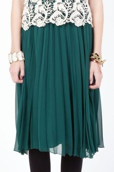 pleated green midi with crocheted top