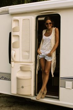 So cooool...faded jean shorts, chic long crochet vest.