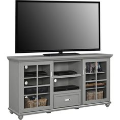 """Add an elegant touch to your living room with the beautiful design of the Red Barrel Studio Gullette 59"""" TV Stand. This TV Stand accommodates flat panel TVs up to 55"""" wide. The stunning sliding glass doors and decorative molding and feet make this piece a conversation starter. Red Barrel Studio Gullette 59"""" TV Stand ships in 2 boxes and requires upon delivery."""
