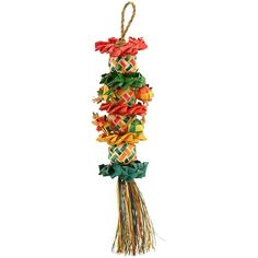 Flower Tree Parrot Toy - Small Earth friendly shredding and preening toy for pet birds.   Naturally coloured palm leaf ribbons are one the most beloved shredding materials of pet parrots. Now your bird can enjoy a whole tower of woven palm leaf ribbon baskets, plus other interesting shapes including moons and stars tied on using sisal rope.