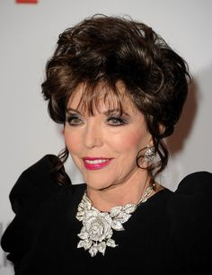 Joan Collins Bobby Pinned Updo - Joan Collins smiled for the camera at the opening gala of The Resnick Pavilion wearing a chic bobby-pinned updo.