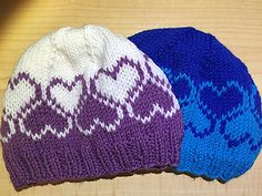 This pattern is worked with two different colors of worsted weight yarn and creates a two rows of hearts around the hat.