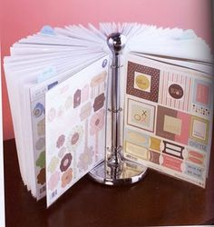 Ingenius way to store scrapbook embellishments...put in pager protecters, on binder rings, and store on a paper towel holder.