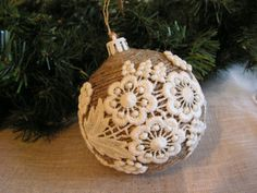 Handmade Rustic christmas ornament wrapped arround with old rope, and decorated with very old French cotton lace. A special and rare item. They look