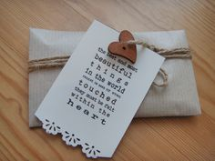 Outer wrapping for bridal token. Wrapped in brown paper, tied with burlap string with a wooden heart button and gift tag.