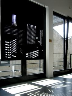 Better View is a series of perforated black out roller blinds designed by Elina Aalto for IUKBOX. Light seeps in through the small cut out holes creating an image of a city by night. The cut-outs represent the light in the windows of apartment buildings and office complexes in the city.
