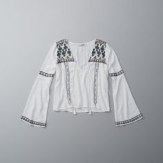 Abercrombie & Fitch Embroidered Tassel Cropped Peasant Top ($58) ❤ liked on Polyvore featuring tops, white, tassel crop top, white crop top, embroidered crop top, embellished v neck top and white peasant top