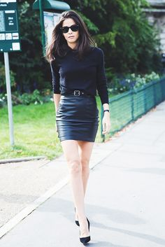 A black-on-black look with a black sweater and leather miniskirt.