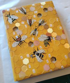 book cover: embroidered bees and hexagons