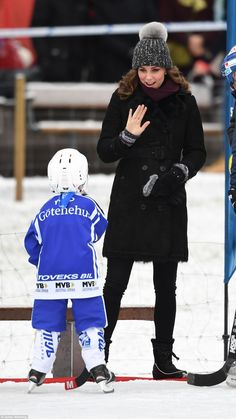 The Duchess kept cosy in a shearling coat by Burberry and wore a grey woolly hat with a ch...