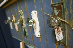 Coat rack made from vintage glass door knobs. Love how they kept the original plates behind them to!