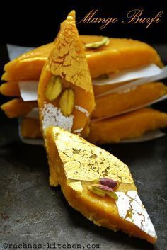 Mango burfi recipe with step by step pictures. Mango burfi is a super delicious treat for mango lovers. My version of mango burfi is smooth, rich and creamy Holi Recipes, Sweets Recipes, Cooking Recipes, Köstliche Desserts, Delicious Desserts, Yummy Food, Indian Dessert Recipes, Indian Sweets, Burfi Recipe