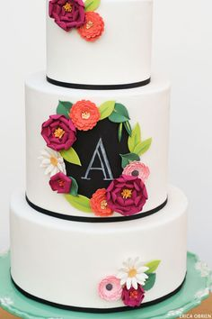 Chalkboard & Paper Flowers     translating trends into cake designs   by Erica Obrien for TheCakeBlog.com.  I LOVE this cake and the style & color of the flowers.  Beautiful :)
