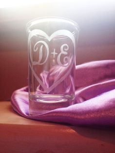 Initials Inside Heart Personalized Shot Glass or Dessert Glass 1.5 Ounces  Perfect for your bachelorette party, engagement favors, or wedding favors! Beautifully hand-etched with the couples' first initials inside of a heart. These cute glasses can double for a shot glass or for single serving ...