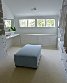 Kensett Norwook master closet: just needs an island where that ottoman is for more storage. Designer: Lynn Morgan Design
