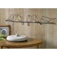 Graham and Brown decorative metal birds. http://www.worldstores.co.uk/p/Graham_and_Brown_Metal_Art_Birds_on_A_Wire_Canvas.htm