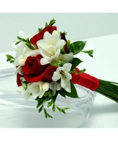 Three Rose Bouquet Freesia Red Vegas Wedding Flowers is part of Red bouquet wedding - This bouquet has three sensational roses surrounded by beautiful mixed greenery and matching ribbon Prom Bouquet, Red Bouquet Wedding, Red Rose Bouquet, Prom Flowers, White Wedding Flowers, Bride Bouquets, Rose Wedding, Bridesmaid Bouquets, Wedding Shoes