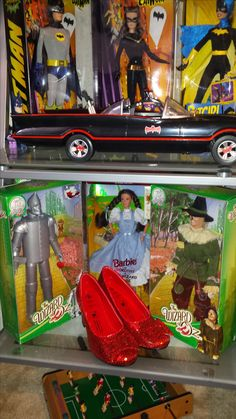 My Barbie Collection in boxes(Never Opened) as of May 2017.  DC Characters: Batman; Catwoman; and Batgirl.  Wizard of OZ Characters: Tinman; Dorothy; and Scarecrow.