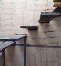 CANTILEVERED-STEEL-STEPS-WELDED-TO-STEEL-BASEPLATES-ATTACHED-TO-CONCRETE-WALL