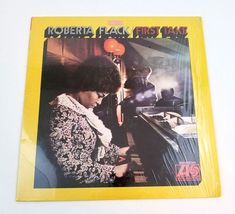 First Take is the debut album by the jazz/soul/R&B singer Roberta Flack. It was released in 1969 on Atlantic Records. The vinyl and label may appear used, but well cared for. Lp Album, Debut Album, Roberta Flack, Atlantic Records, Vinyl Records, Albums, Singer, Singers