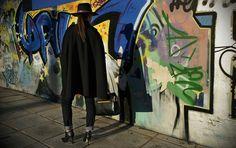 Black cape, graffiti, hat, bag