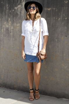A classic button-down and denim skirt are quintessential Americana. While the look is ideal for a day at sea, neutral-toned wedges, a wide-brimmed hat, and a bag decked out with grommets make this outfit perfect for the urban sprawl.