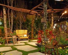 aménagement jardin extérieur - sol en dalles de pierre, canapé droit en bois massif et déco vintage