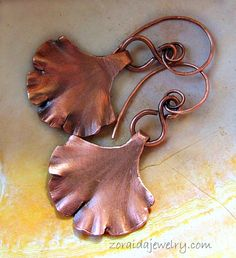 Copper Ginkgo leaf earrings cut from sheet metal