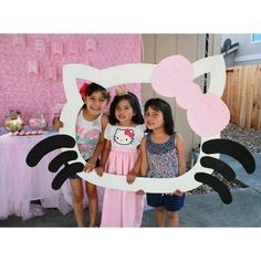 I made this Hello Kitty Photo Booth Frame for my 5 year old daughter's birthday party, and my guests loved it! I used plywood, cardboard, paint, and hot glue. get some yourself some pawtastic adorable cat apparel! Hello Kitty Photos, Hello Kitty Themes, Hello Kitty Cake, Hello Kitty Parties, Hello Kitty Pinata, Hello Kitty Birthday Theme, Cat Birthday, 6th Birthday Parties, Hello Kitty Wedding