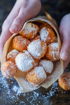 Zeppole donuts are rolled in sugar with a fluffy, melt-in-your-mouth center. These Italian donut holes are simple to make and always disappear fast. Italian Donuts, Italian Desserts, Just Desserts, Delicious Desserts, Dessert Recipes, Dessert Cups, Christmas Desserts, Donut Recipes, Cooking Recipes