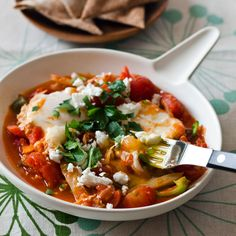 Shakshuka with Fennel and Feta | F&W's Gail Simmons eats these eggs cooked in a tomato and bell pepper sauce for any meal of the day.