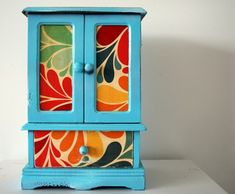 Originally a wood vintage jewelry box upcycled to create a bright, whimsy and unique jewelry box.  - Doors open to reveal original mirror and